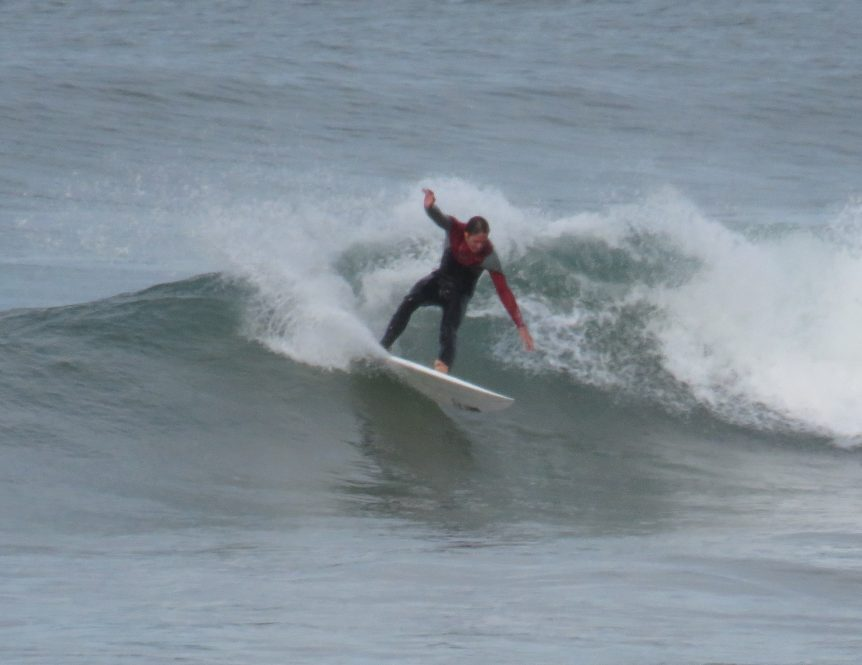 Surf coach having fun surfing at Woolacombe bay, surf lessons given by real surfers, surf school fun