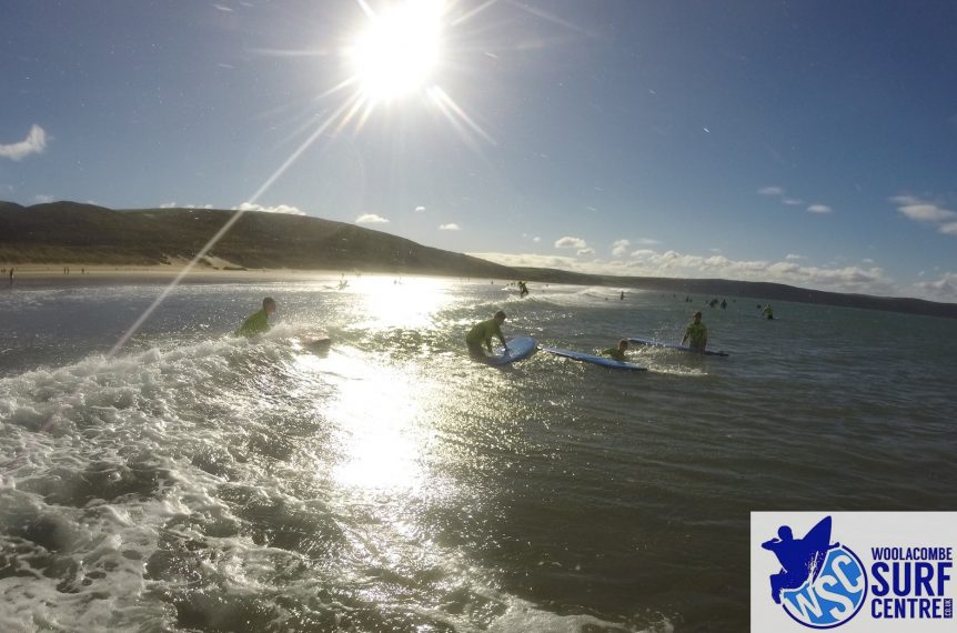 Group surf lesson in the summer on Woolacombe Beach with Woolacombe Surf Centre