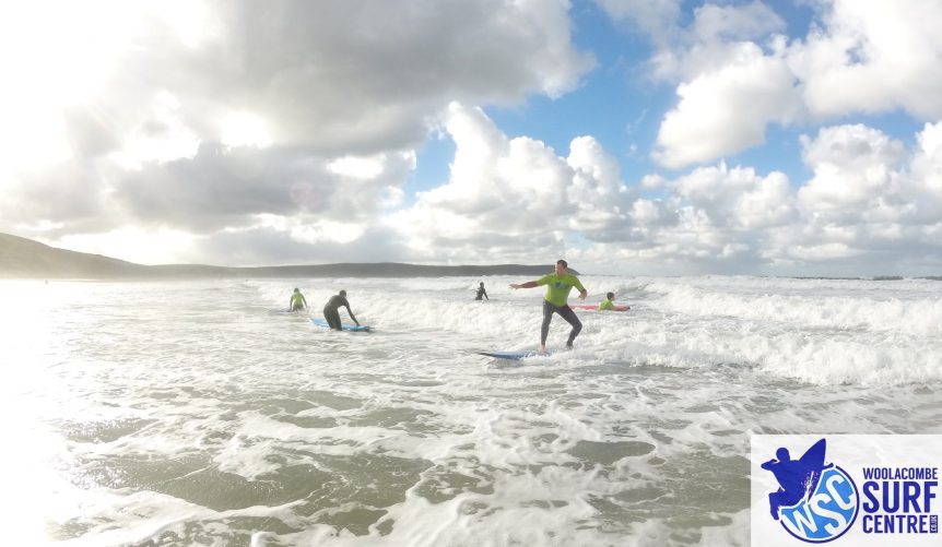 Group surf lesson on Woolacombe beach near Croyde Bay and Saunton Sands. Surf lesson with Woolacombe Surf Centre
