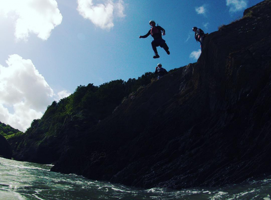 Coasteering with Woolacombe Surf Centre, jumping off the rocks into the sea