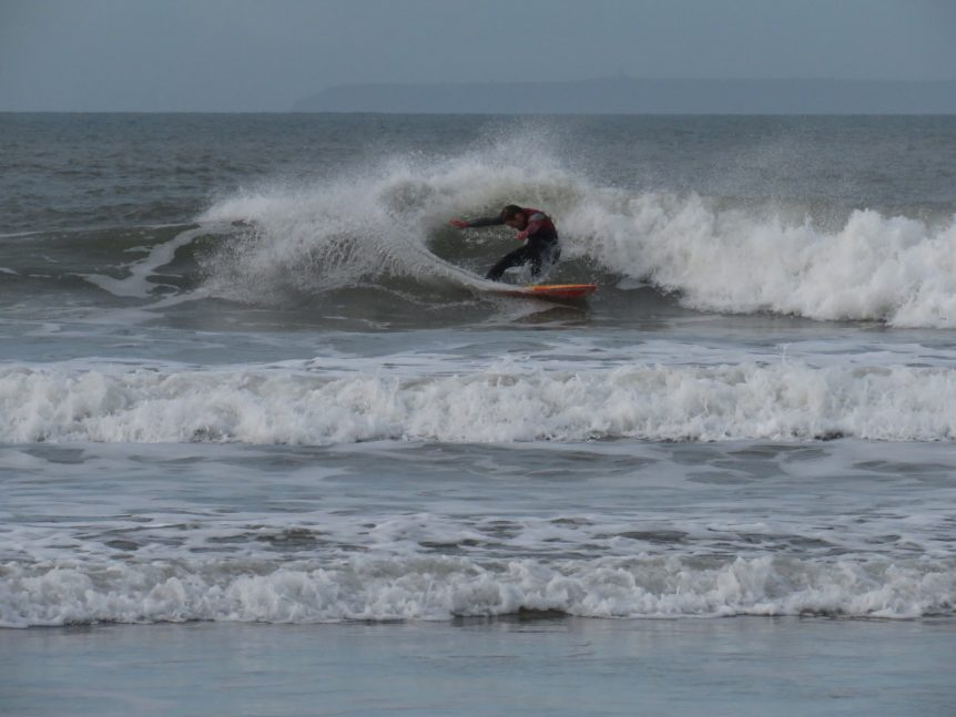 Woolacombe Surf Centre's head coach Gary King surfing at Woolacombe Beach, surf lessons