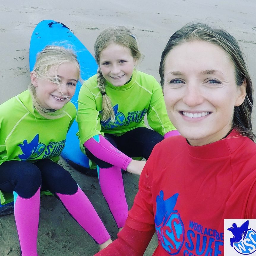Girls surfing, smiley happy surfers, female surfing learn to surf with Woolacombe Surf Centre