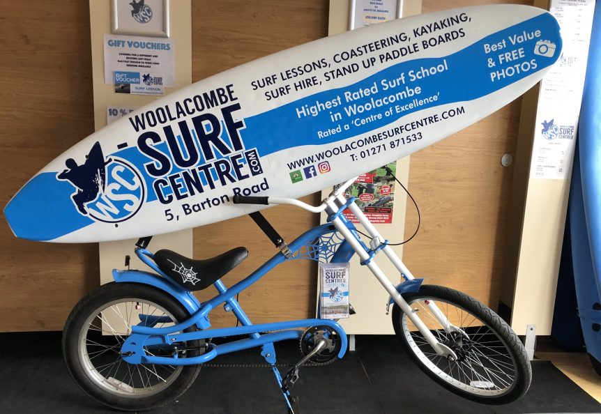 Woolacombe Surf Centre bike, iconic bike, surfboard, surf lessons at Woolacombe