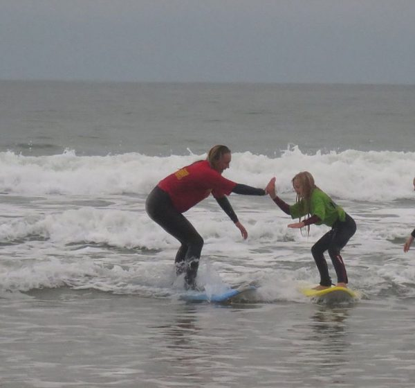 Woolacombe Surf Centre surf coach high five girls surfing learning