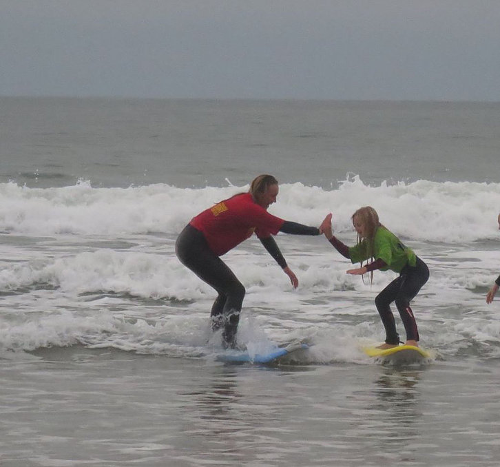 learn to surf here at Woolaomcbe Beach with Woolacombe Surf Centre, surf school, surf lessons