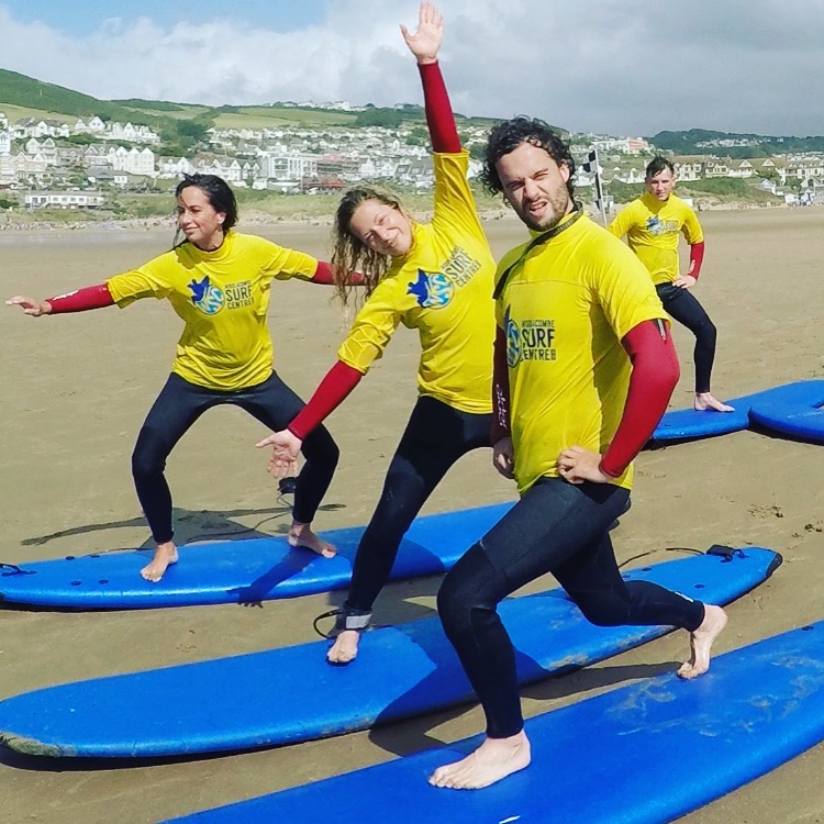 group surf lessons for fiends of all ages and abilities surfing with Woolacombe Surf Centre, getting free photos to cherish the fun times and memories