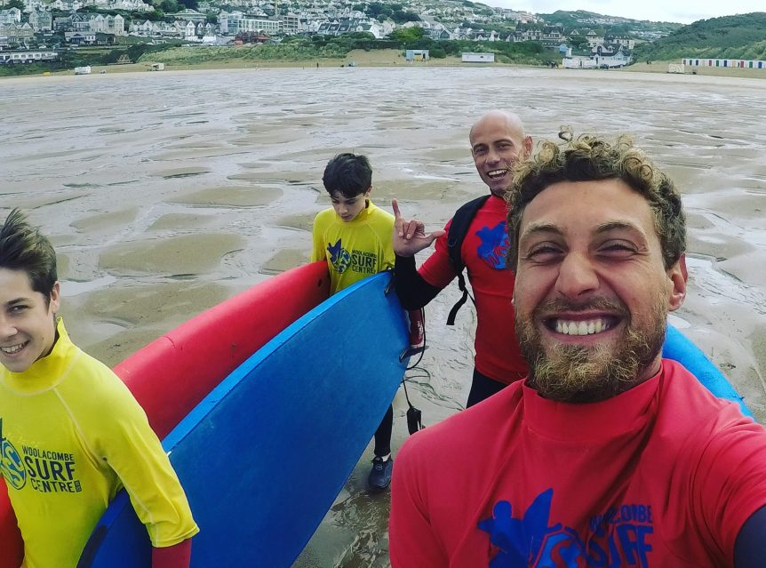 Friendly happy team teaching surfing to all abilities Woolacombe beach north Devon near Croyde and Saunton