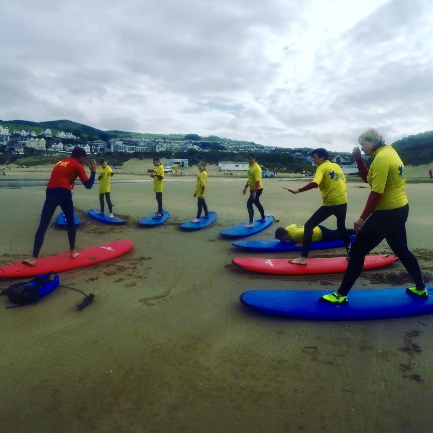 surf lesson on Woolacombe Beach, Woolacombe Bay North Devon. First time surfers