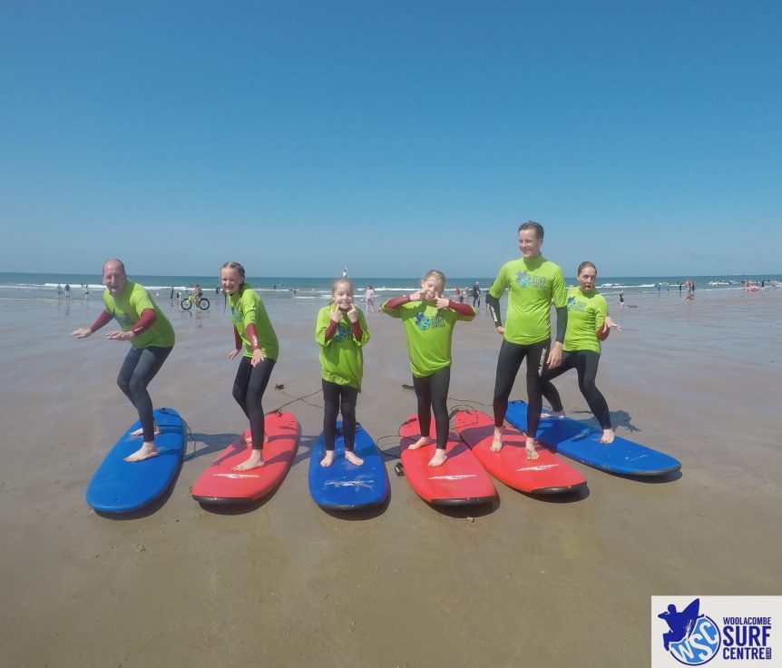 Family fun in the the with Woolacombe Surf Centre, surf school. Sunshine, sea and sand