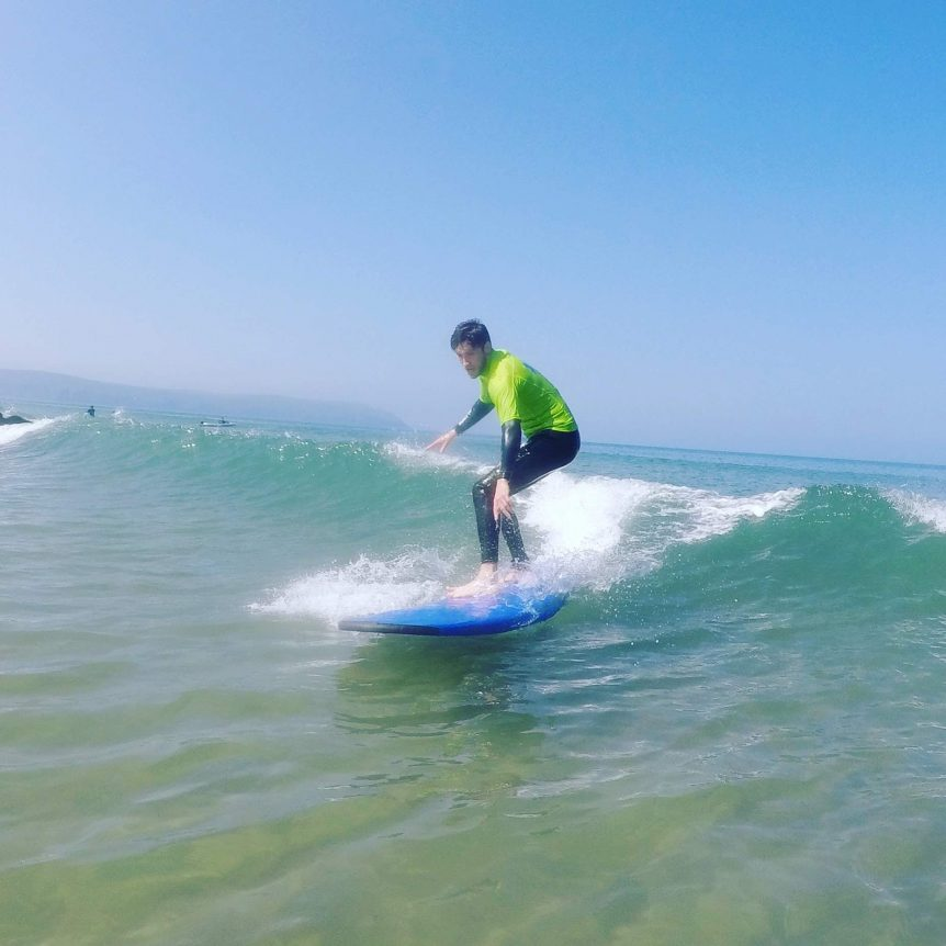 First time surfer, learning to surf with Woolacombe Surf Centre at Woolacombe Bay North Devon, near Croyde and Saunton