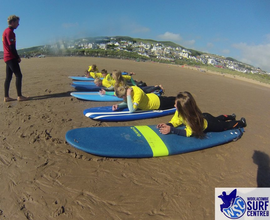 Grom squad surf training session with Woolacombe Surf Centre on Woolacombe beach, surfing in North Devon
