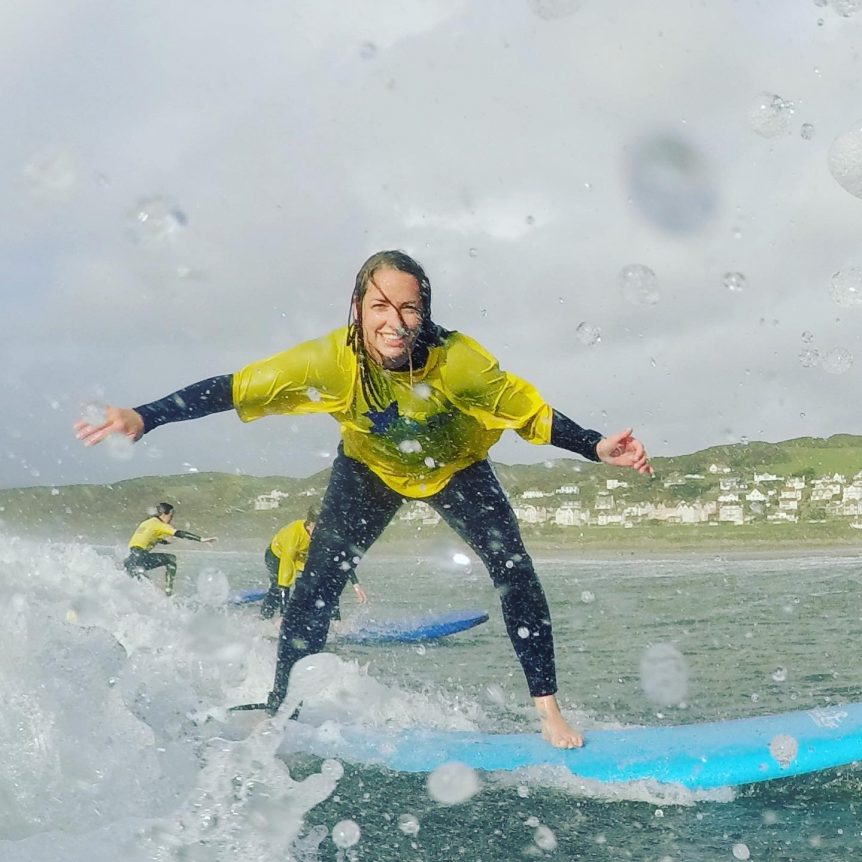 School trip surfing with at Woolacombe Beach with Woolacombe Surf Centre, smiling and having fun!